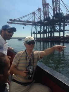 A former container ship captain points out various aspects of the harbor.