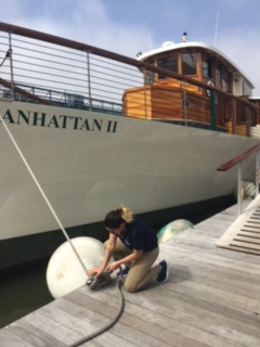 The image above is me putting figure eights on the cleat to hold  Manhattan ll  On to the dock.