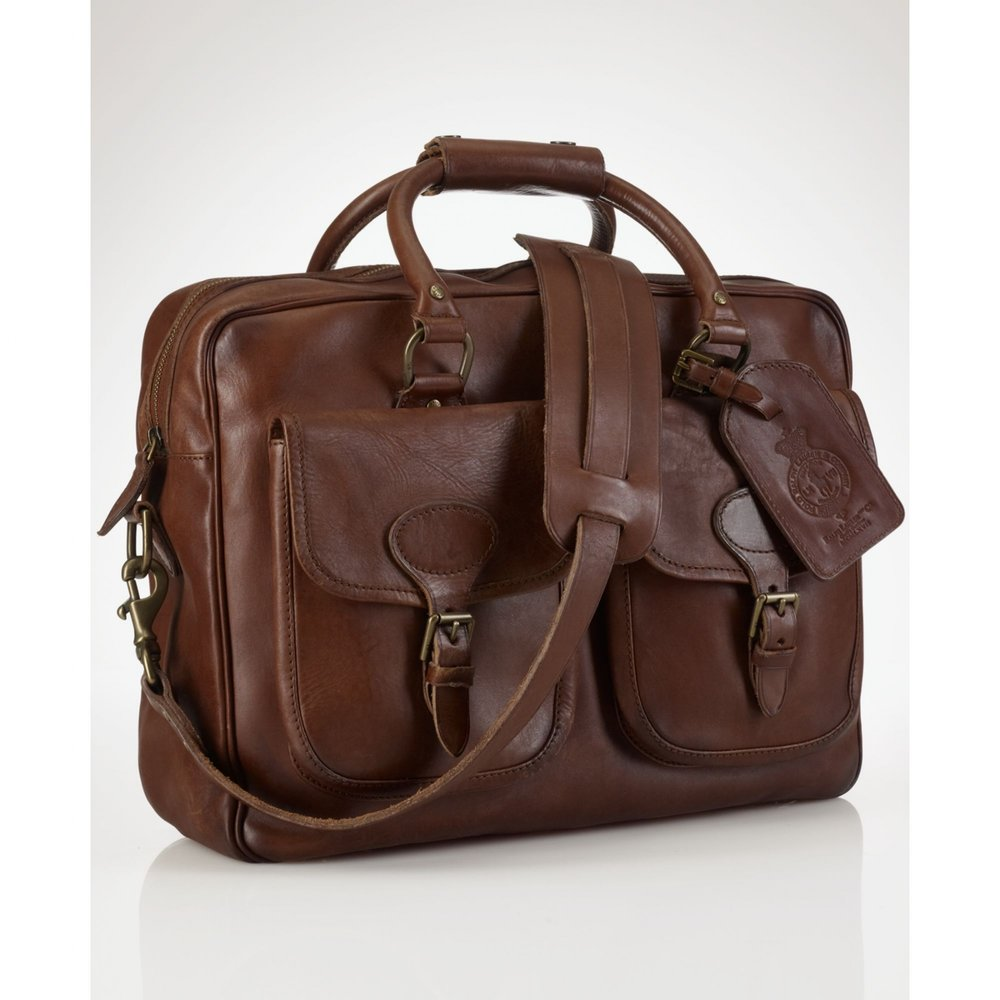Ralph Lauren Commuter Bag - Commuting can be awful. Help make your graduates future a little bit easier by giving him the gift of stylish organization. This Leather bag will pass the test of time, and do it while looking professional. You can find this item on Macy's website along with the other stylish work bags they have to offer.