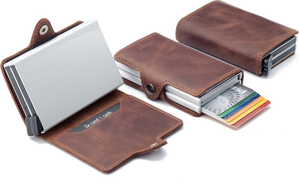 Secrid Wallet - This uniquely styled, luxurious wallet helps protect your cards from unwanted RFID and NFC communication. Made of genuine leather this wallet adds a fresh style along with a new innovative feature. Simply slide the bottom button and have your cards pop up at the top. To check out this technology and all the styles offered hop on over to Secrid's page
