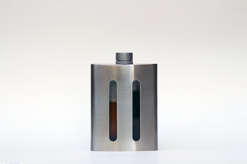 Dividere's Dual Chambered Flask - Every working man needs a hip flask right?Help the newly graduated sip his favorite spirits with this high quality stainless steel flask. Dividere Stainless offers an innovative feature on their flask that is new to the scene. The flasks unique top allows its user to be able to switch between two types of liquor on the fly. Simply twist the top and enjoy one side, twist again for the other, then one more twist to allow both sides to pour at the same time. Visit Dividere Stainless to check out their designs which include a selection of stainless steel and leather bound flasks.