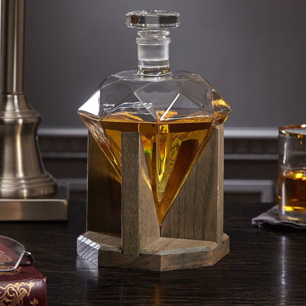 Diamond Decanter - The diamond decanter comes with a red oak stand and is the perfect statement piece for any bar or bar cart. Although definitely valuing elegance over functionality the decanter still holds an astonishing 33 ounces. Perfect for the friend who values class and needs something to really steal the show.$160 CADLearn More