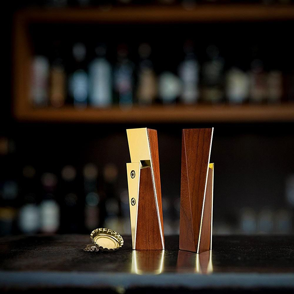 Acacia & Gold Bottle Opener - Smooth wood blended with blinding gold. This unique bottle opener shoots up from the table top with aesthetics that almost make you shy away from actually opening a bottle with it. Gift this to your friend who has forgotten how classy beer drinking can be.$60 CADLearn More