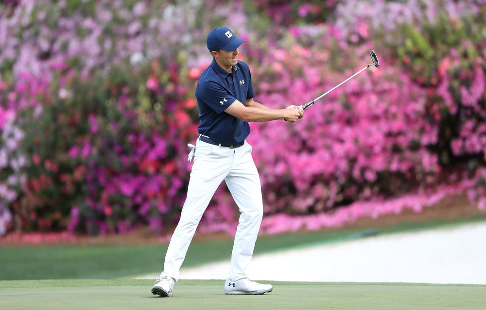 Jordan Spieth thanked his caddy, coach and chiropractor after winning the Masters