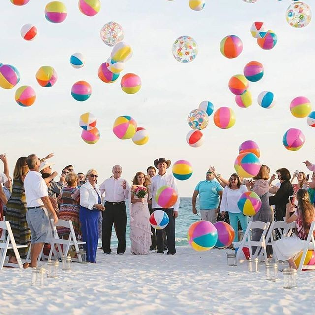 Looking for a unique way to end your ceremony on the beach? Beach Balls Wedding Sendoff Photo by PWV @klewisphotography . . . #klewisphotography #weddingexit #weddingphotos #pensacolabeachwedding #desinationwedding #beachball #weddingbeach #pensacola #pensacolabeach #pensacolaweddingvendors