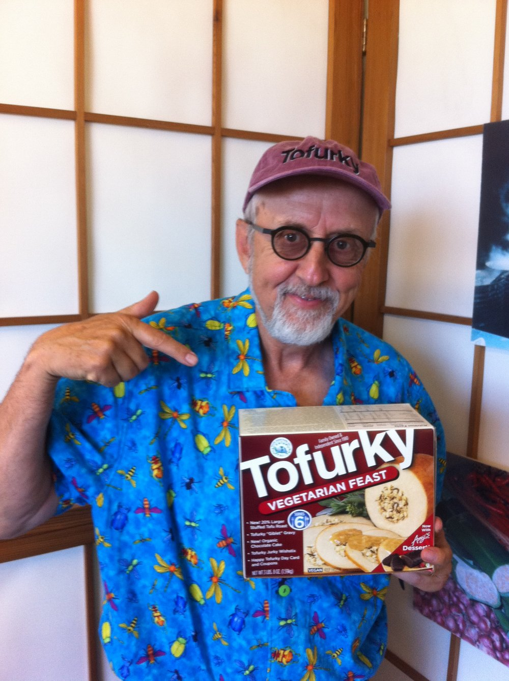 "SETH TIBBOTT - Seth Tibbott founded Turtle Island Foods, dba ""The Tofurky Company"" in 1980 on $2,500, his life savings from his 8-year career as a teacher/naturalist in the Portland, Oregon public schools. The company's first product, tempeh (a fermented soy bean cake from Indonesia), was made and delivered in small batches to fledgling natural food stores in Portland and the west coast.The first 9 years in business were a financial struggle. America was not quite ready for tempeh yet and Seth's take-home pay averaged $290 for those years. Living the dream but losing his shirt, Seth rented four trees in 1984 near the tempeh shop for $25.00 per month and built a 3-story tree house in which he lived for the next 7 years.In 1995, the company's fortunes changed with the introduction of the first Tofurky roasts at Thanksgiving. 500 roasts were sold that year throughout the Pacific Northwest but soon a larger, national market came calling.Today, 38 years after its founding, Tofurky is still a family owned, independent enterprise and Seth is the company's Chairman and stepson, Jaime Athos is now CEO, carrying the dream forward. Tofurky is a model of ""slow growth"" and is unique for never having any equity investment except for $17,000 from Seth's brother Bob in 1989. Today, Tofurky products are sold in over 21,000 stores worldwide on 6 of 7 continents and are made in a new eco production plant built to LEED Platinum standards. Seth has been overseeing Tofurky sales in the export market for the past 4 years which has afforded him the opportunity to witness firsthand the current explosion of veganism throughout the planet."