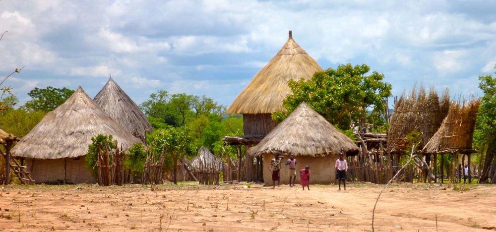 Children-standing-outside-Tonga-villiage-of-thatched-mud-huts-near-Binga-Zimbabwe.jpg