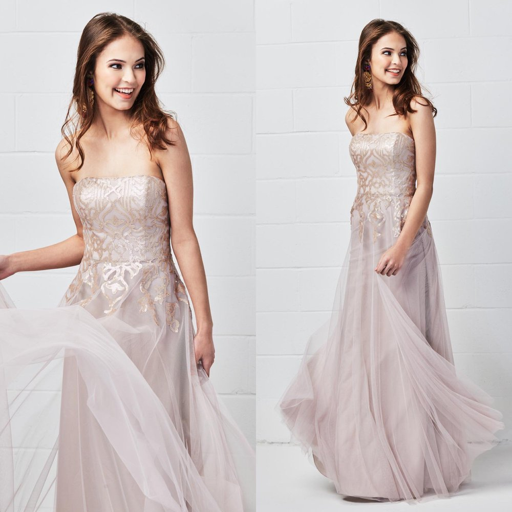 This beautiful A-line bridesmaid dress features Talisa sequins trickling into a bobbinet skirt. A strapless neckline and natural waist provide an ultra-chic but carefree look.