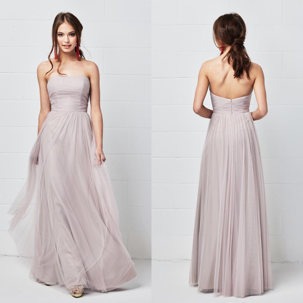 A bridesmaid dress that is both classic and modern, this style features a straight, strapless neckline, a natural waist, and gorgeous bobbinet fabric.