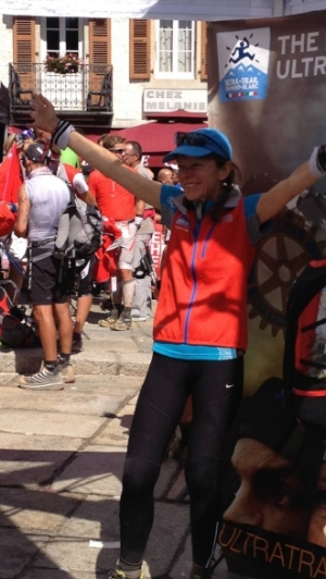 Sandy in her UTMB finisher's jacket looking good!