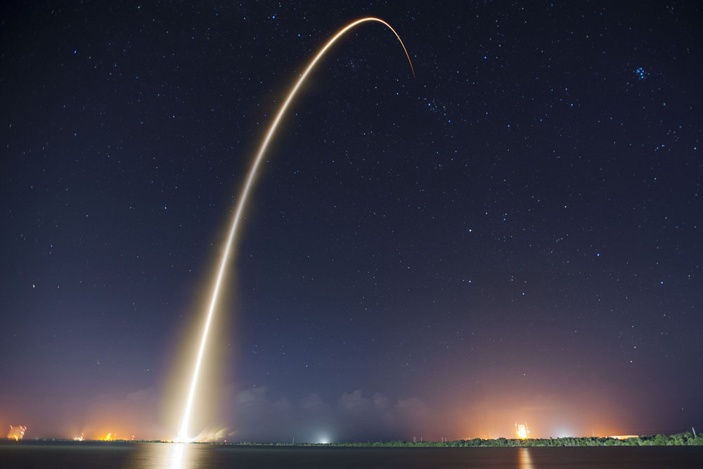 Long exposure of a Falcon 9 launch.jpg