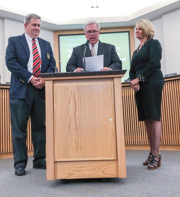 Tooele City Councilman Steve Pruden reads a Tooele City Proclamation recognizing the Boy Scouts Great Salt Lake Council's 100th anniversary. On the left is Darwin Cook, chairman of the Deseret Peak District. Mayor Debbie Winn (right) signed the proclamation. (Courtesy of Kolbie Cook)