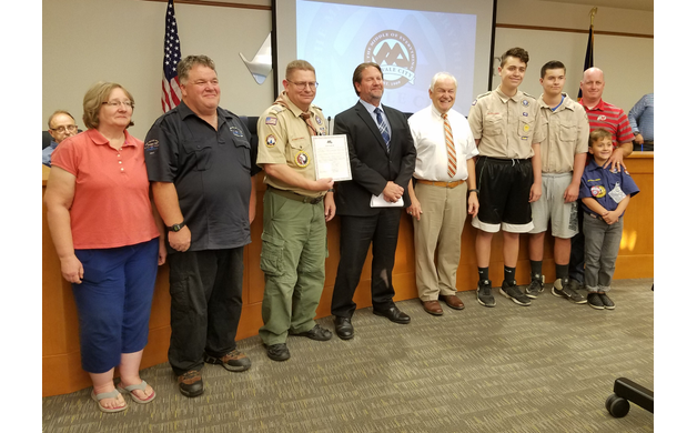 Dennis Hollinger (third from the left), Tony Patterson (fourth from the left), with other Scouts and leaders, receive the proclamation from Mayor Robert Hale. (Ruth Hendricks/City Journals)
