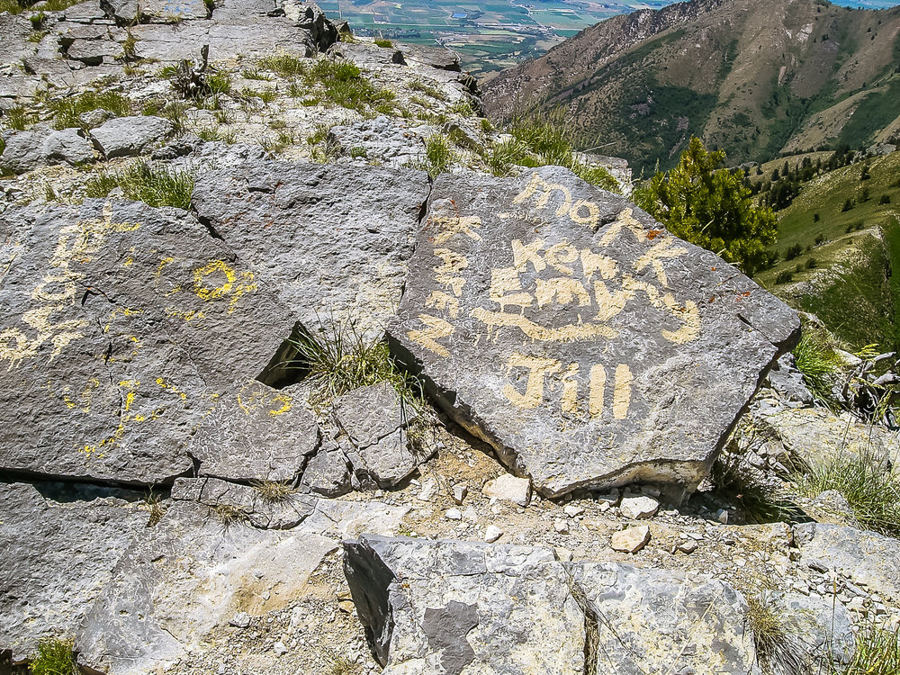 Vandalism at the top of Utah's Cherry Peak. Photo by  Matthew Durrant .