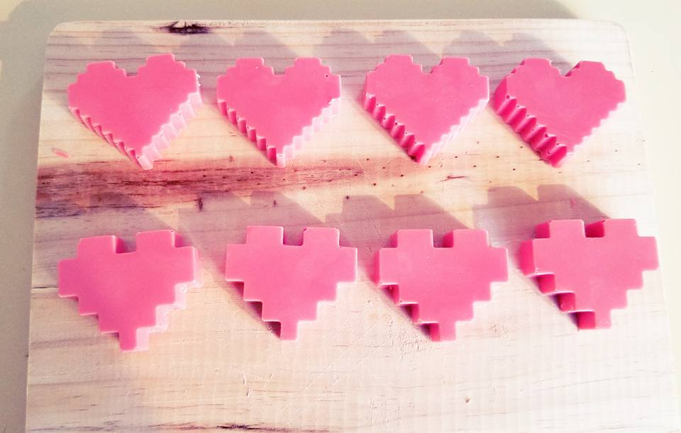 Pixel Love - PINK PIXELATED WHITE CHOCOLATE AND STRAWBERRY HEARTS TO SAVE YOUR S.O. ON THOSE DANGEROUS JOURNEYS.