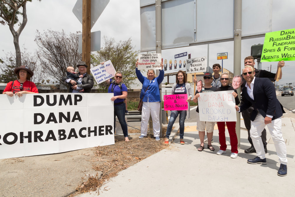 Locals gather for a rally near the billboard on Beach Blvd. in CA-48 in Orange County.