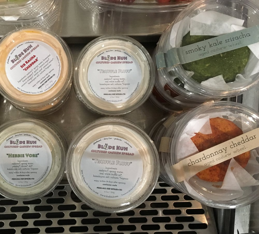 Vegan Cheeses - Our Vegan Cheeses are sourced from the company Blöde Kuh and made from cashews! We stock both their cream cheese styled cultured spreads and dips as well as their aged semi-soft wheels.