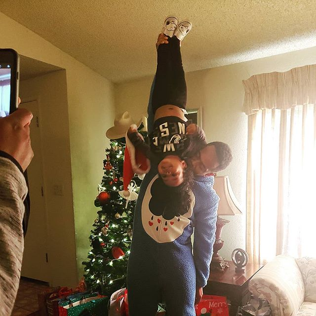 Tumbling coaches like @dreethoven like to hold their nephews upside down from their ankles for Christmas and make them giggle.  _ . . . . . . #christmasfun #merrychristmas #sfbayarea #eclectiksol #babyacro #cultureandlifestyle #fambam #upsidedown #babyacrobat