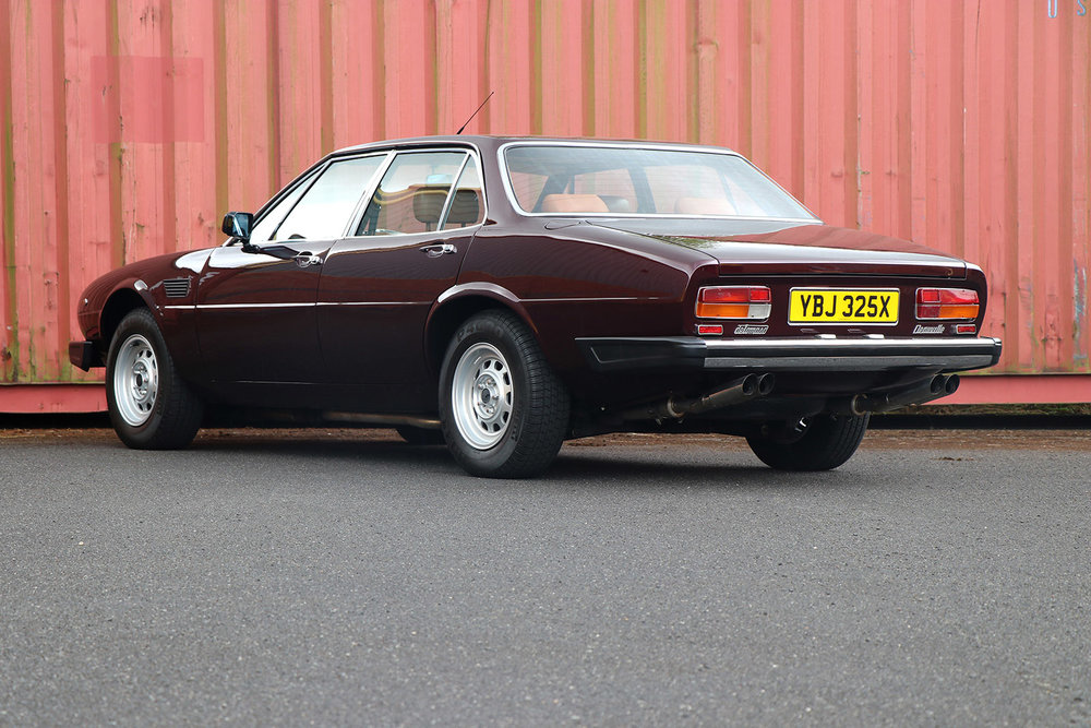 1982 burgundy deauville rear left three quarter web.jpg