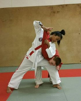 Khun Nang demonstrating white belt