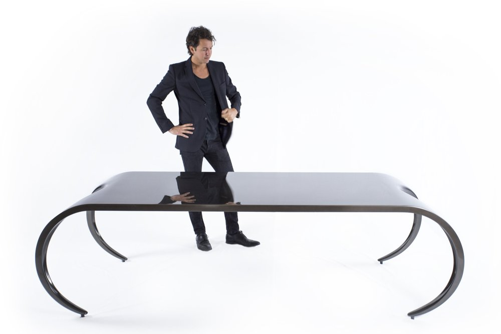 Jonathan Standing with Table.jpg
