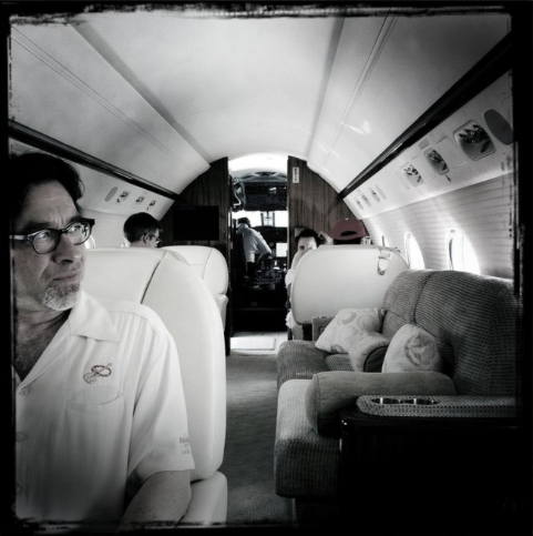 on Glenn's plane heading to work