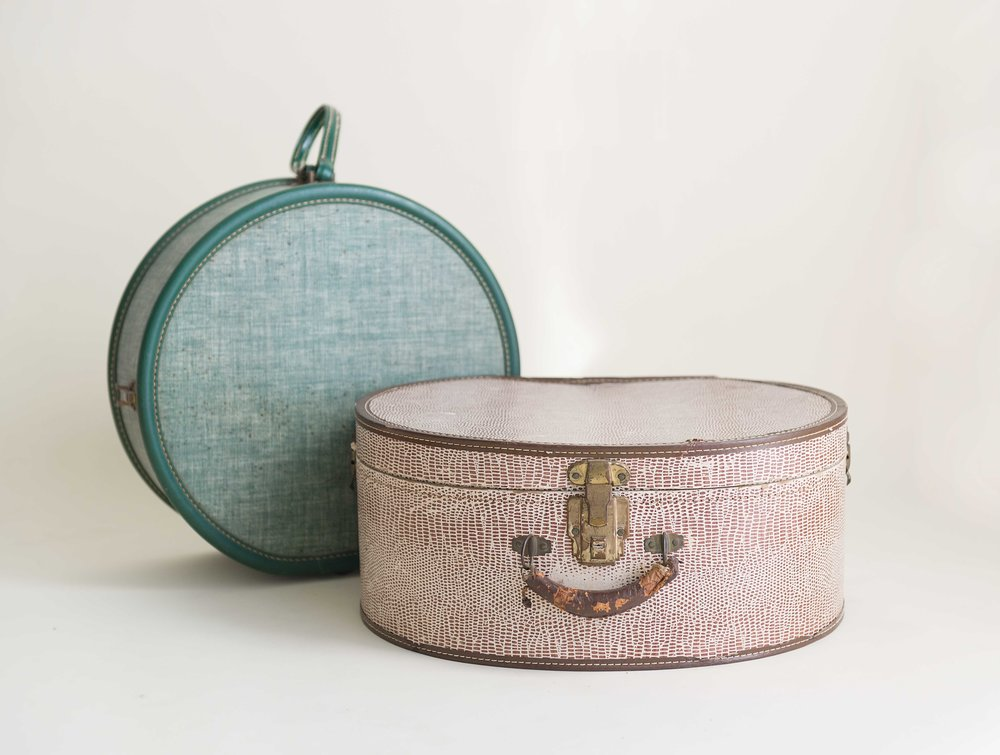 Vintage suitcases make great props because after all, your little one is going places.