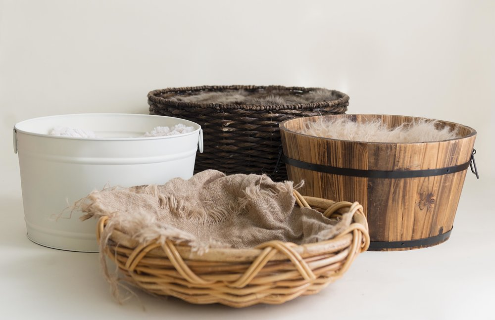 Just a few of the baskets in our studio because nothing is cuter than a baby in a basket or bucket.