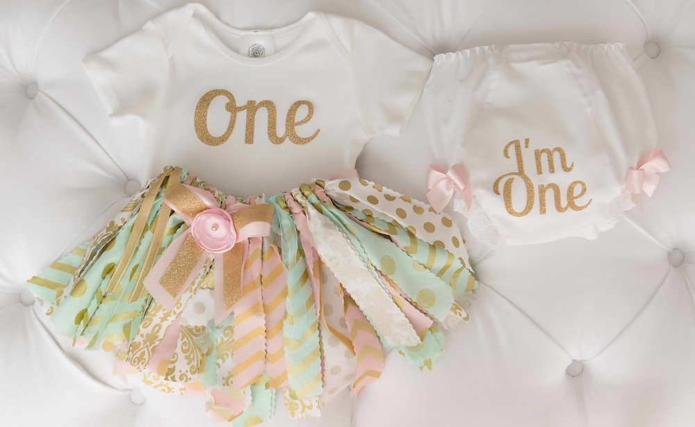 In the studio, we like to mark their major milestones. This darling ribbon tutu, onesie and bloomers set is a popular pop for our baby girls turning one!