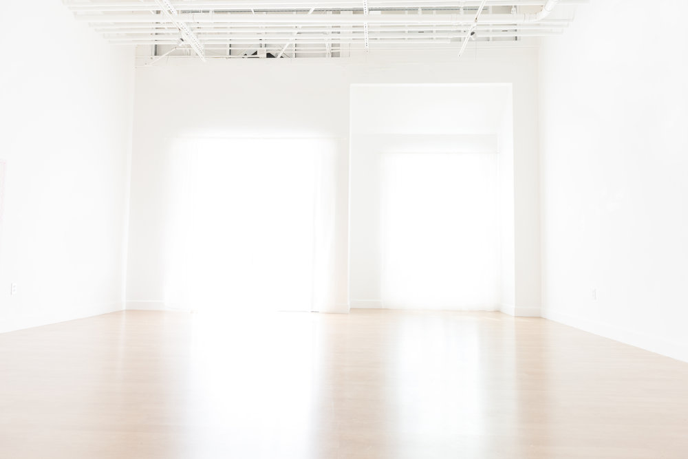 Our studio space boasts wooden floors, tall ceilings and south facing windows and doors which bask the studio in beautiful natural light.