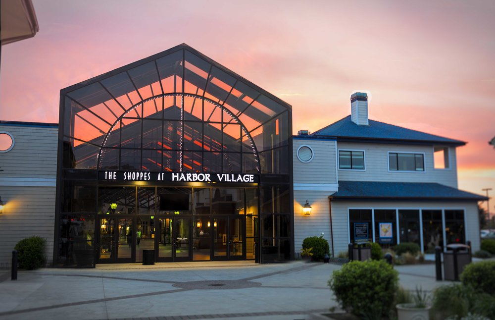 """Red skies at night sailors and photographers delight. The entrance to the """"Shoppes"""" at sunset. Find our studio in Suite 20 of the Shoppes."""