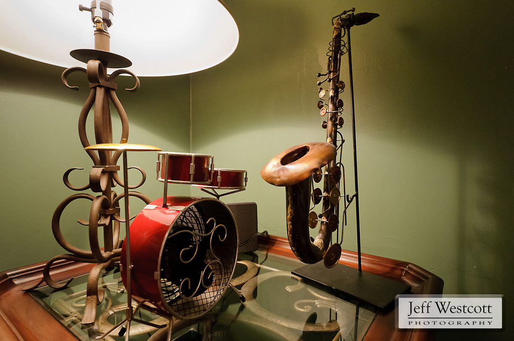 A miniature saxophone and drum set are part of the music-themed décor in Bowersox's office