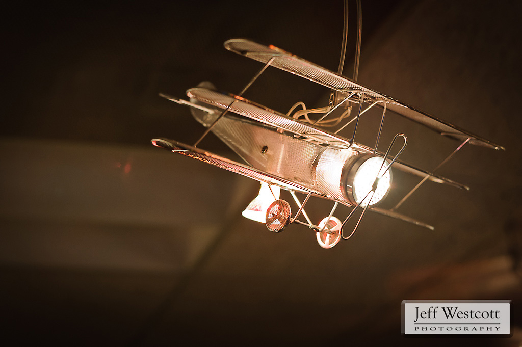 "A model tri-plane is part of a light fixture that spans the ceiling of Steve Bowersox's office. Bowersox found the fixture, called ""Aviation Wings,"" in a Craig's List ad from Seattle."