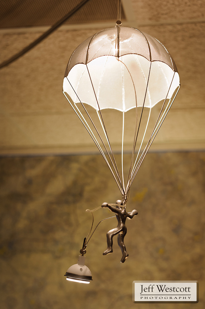 A model parachutist casts light above Steve Bowersox's desk.