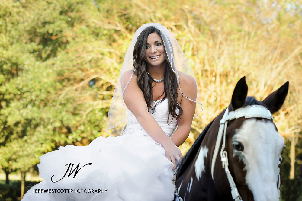 Bride with horse at wedding Golden Ocala