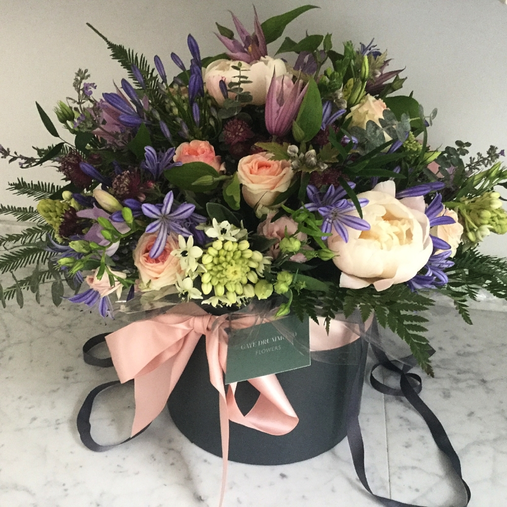 Luxury flowers hatbox, seasonal blooms. £100