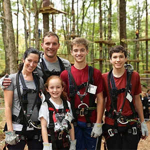 Family climbing at TreeTop Adventures in Canton, MA