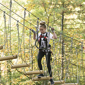 Girl climbing at TreeTop Adventures in Canton, MA