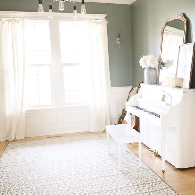 A glimpse of sunshine through my windows brings a whole lot of happy.  Come on, spring! . . . #sunshine #musicroom #whitepiano #paintedpiano #greenwalls #outdoorrug #myhomestyle #paintednonsense #paintthewalls #neutralhome #lightandairy #mystylednest