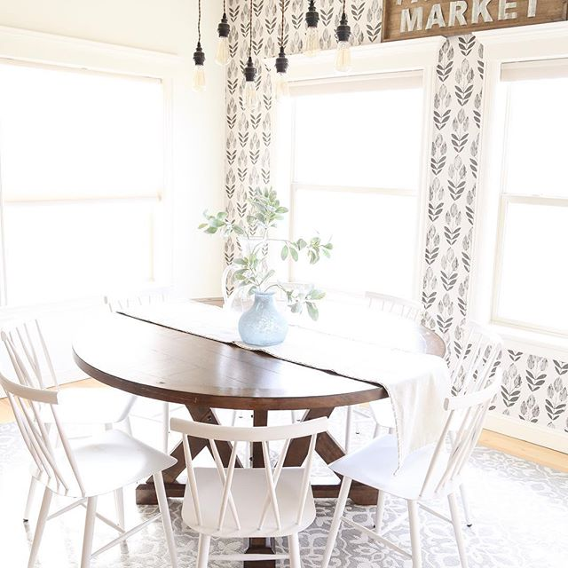 Do you eat at your table or around the bar?  We have a habit of eating around the bar. I've always wanted a round table, now we need to learn to use it. 🤷🏼♀️ . . . #peelandstickwallpaper #paintednonsense #roundtable #farmhousekitchen #modernfarmhousestyle #farmhousestyle #myhomestyle #neutralhome #eatinkitchen #lightandbright
