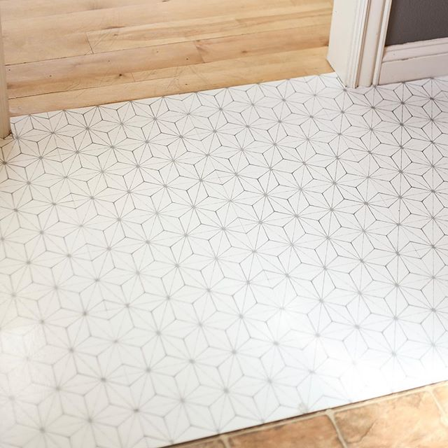 Today I'm trying a temporary floor fix over the top of my existing linoleum floors.  Eventually, I am planning to tile these floors, but for $60, this seems like a good temporary solution.  We will see! . Do you have any spring projects in mind?? I love this time of year! . . #peelandsticktiles #budgetmakeover #bettethanbefore #lightandbright #babysteps #diyeverything #diyproject #projectmama