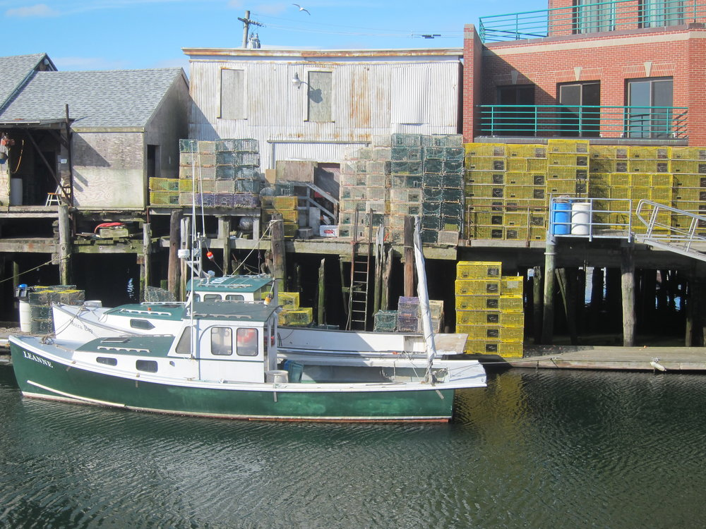 Lobster boat and traps.JPG