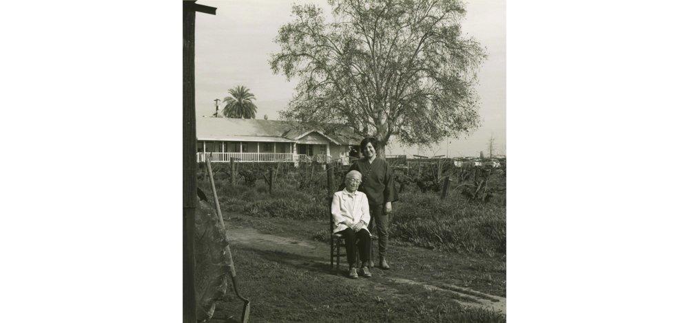 Nikiko Masumoto stands behind her grandmother, Carole Yukino Sugimoto Masumoto, on the Masumoto Family Farm in Del Rey, California.