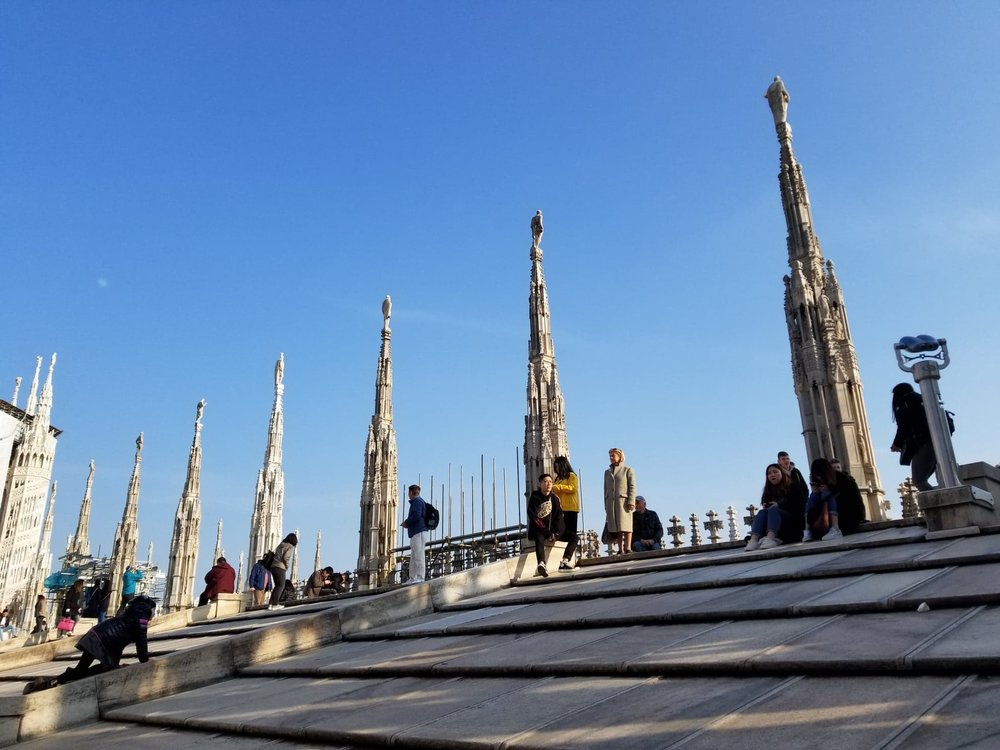 Scaling the roof at the Duomo