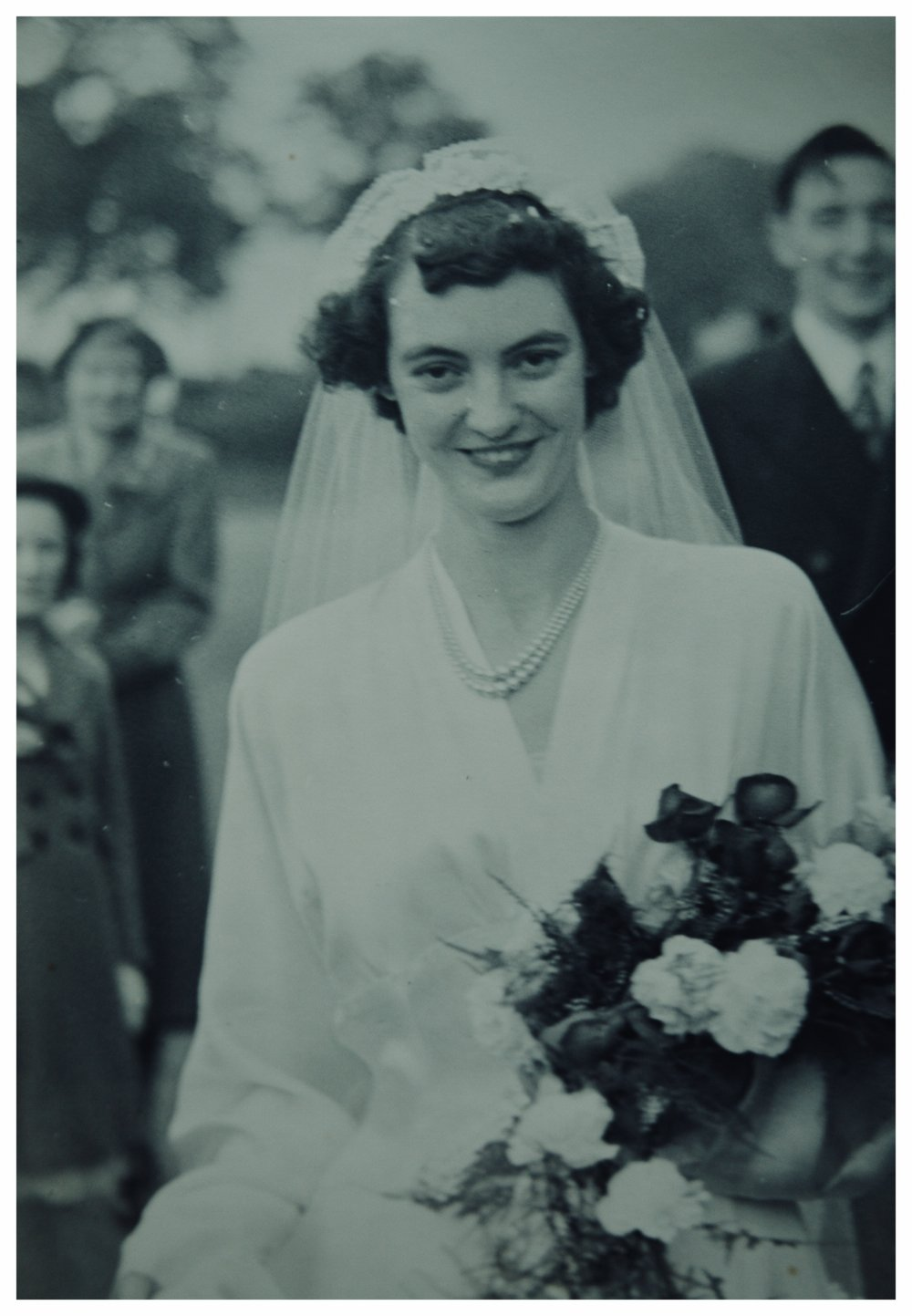 My Grandmother Ellen, on her wedding day. You can see my grandfather grinning in the background. (She always loved carnations & marigolds.)