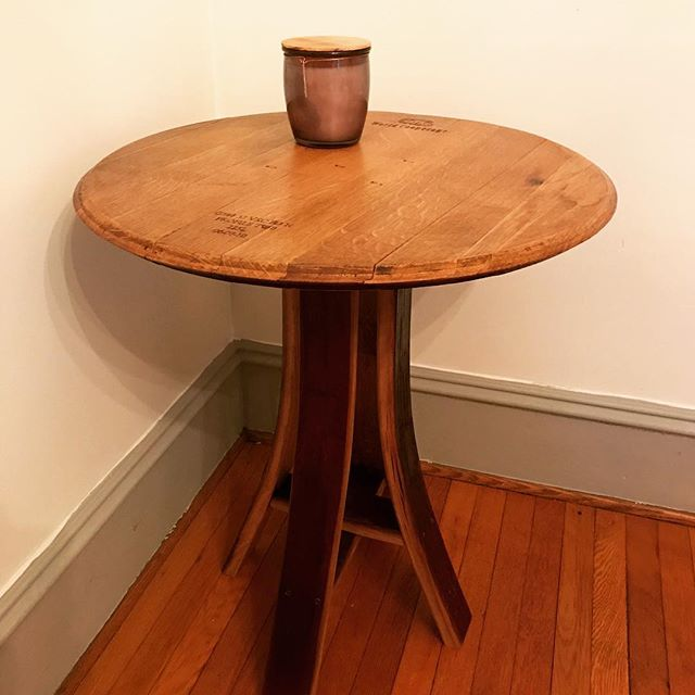 Barrel head table with wine stave base. In the home of a happy customer! Contact us for more info on other barrel furniture. #barrels #barrelfurniture #winebarrel #whiskeybarrel #staves #woodworking #homedecor
