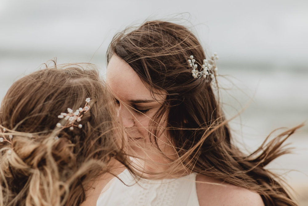 Cliffs of Moher wedding. Two brides kissing.