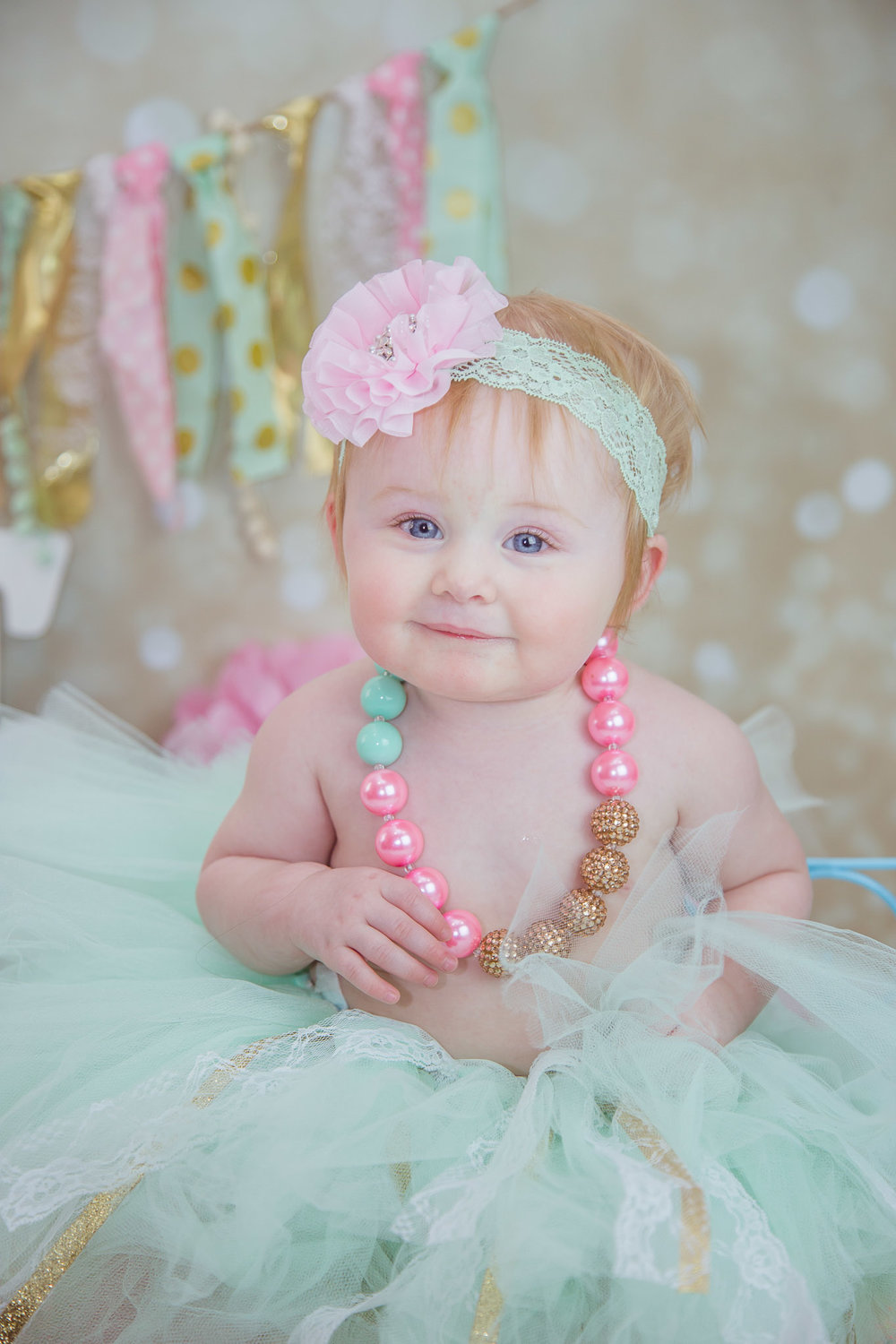 one year photo in tutu and pearls