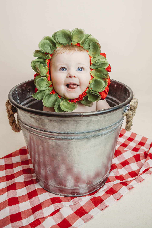 strawberry baby in bucket