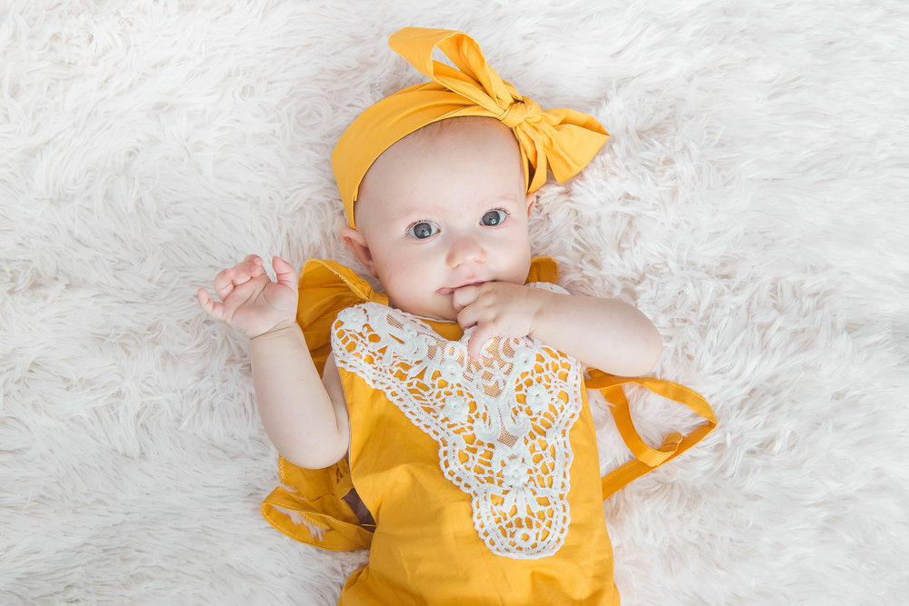 6-month-session-girl-yellow-bow.jpg